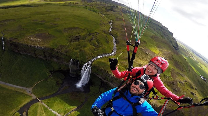 Tandem Paragliding over a waterfall near Reykjavik