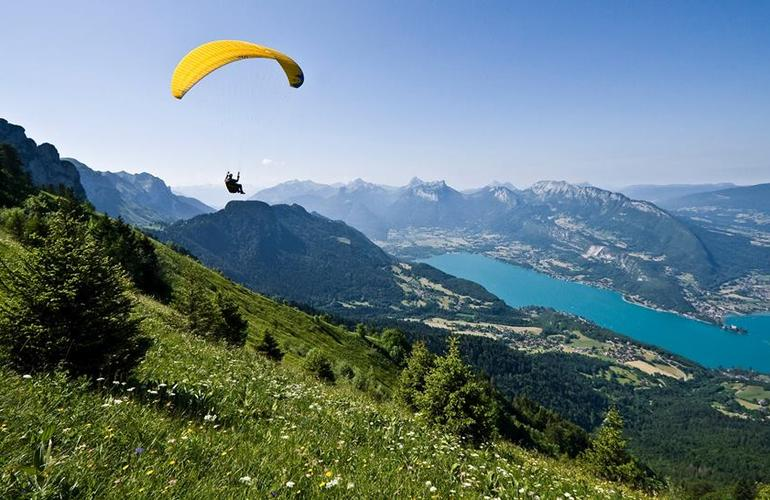 Paragliding over Valleys and Blue Lakes