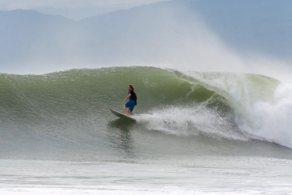 Surfer surfing in Mexico best places to go in winter