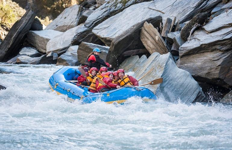 Whitewater river rafting in Shotover river in Queenstown.