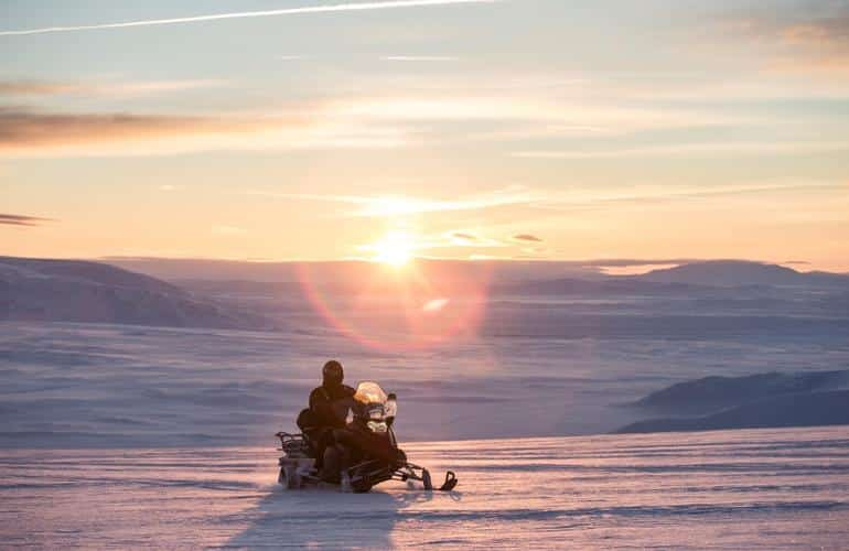 Snowmobile in Iceland during sunset on our list of  everything about snowmobiling