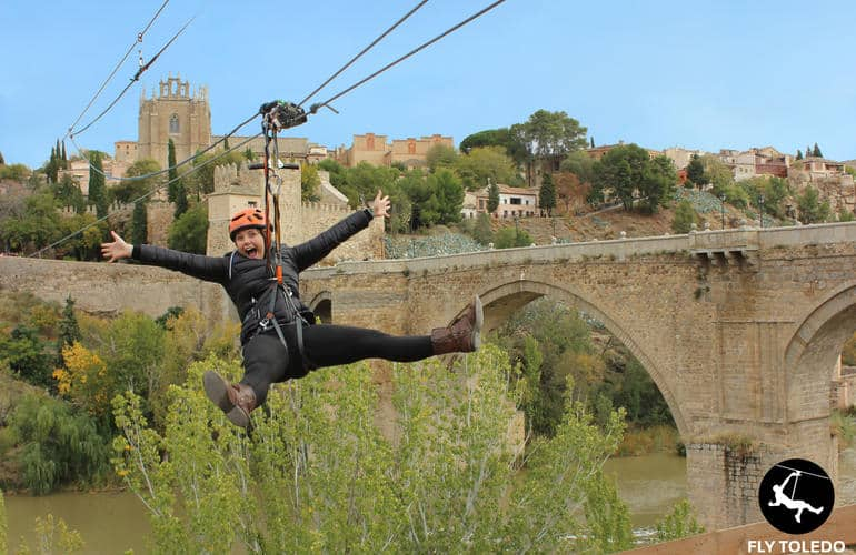 Woman ziplining above the village of Toledo and the San Martin river