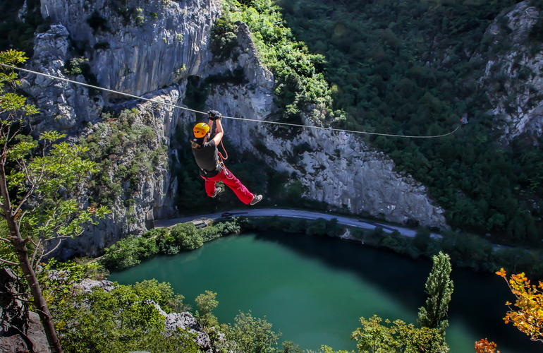 Zipline above the exceptionnal river and forest of Cetina in Croatia