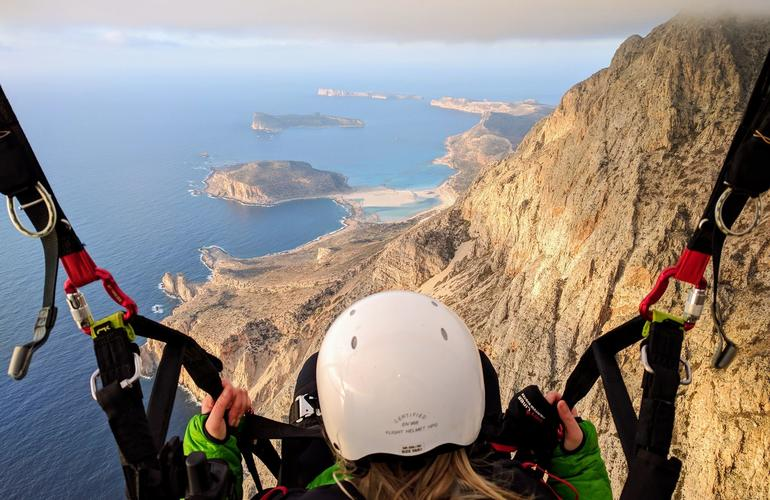 People Gliding above Crete Island in Greece