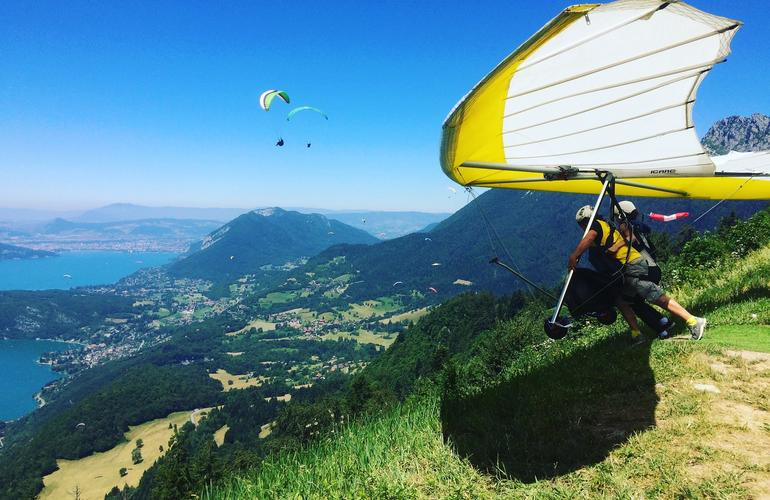 Hang gliding above Annecy Lake in France