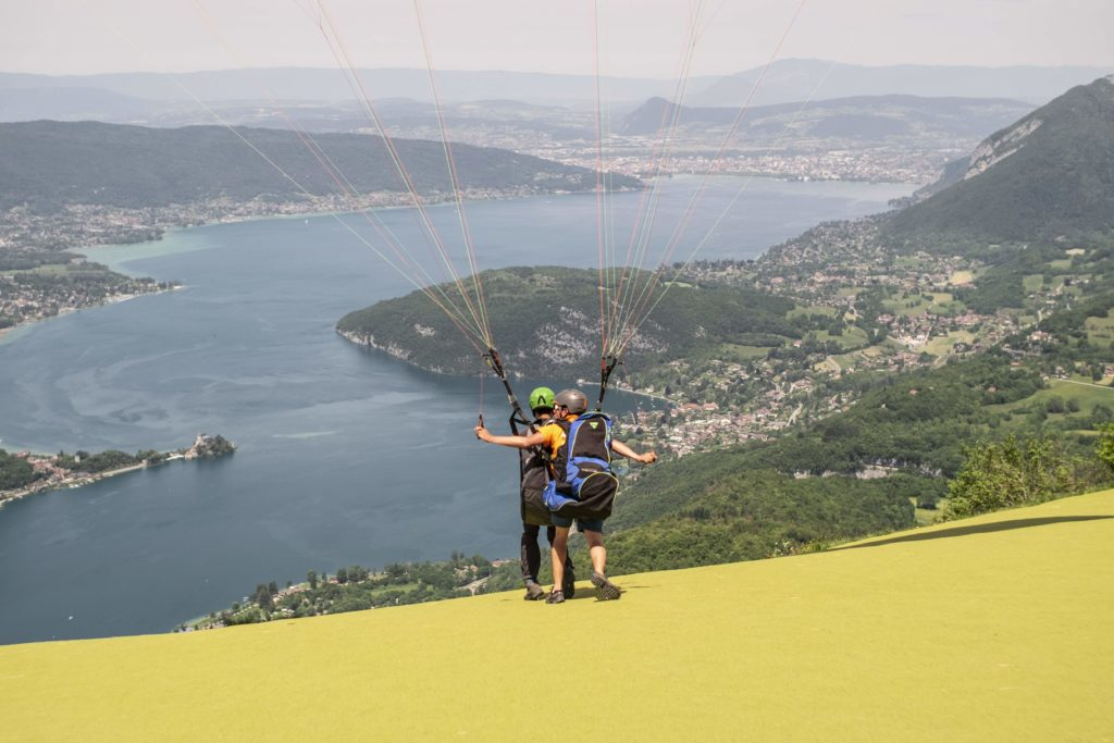 Taking off in Annecy, above the lake